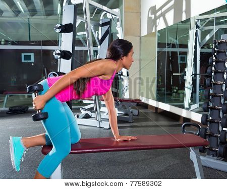 dumbbell triceps kickback girl workout exercise at gym