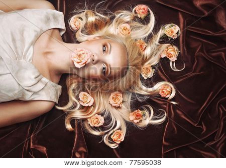 Sensual Tender Woman Portrait With Unusual Magical Gaze And Peachy Roses In Hair
