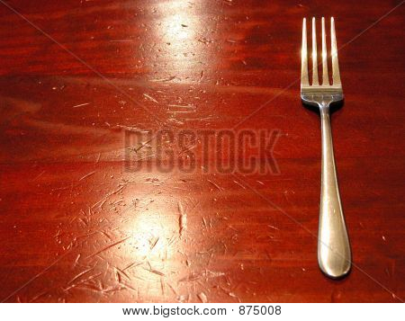 Fork On A Well Worn Table