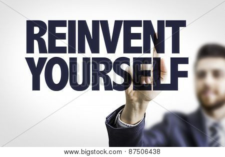 Business man pointing the text: Reinvent Yourself