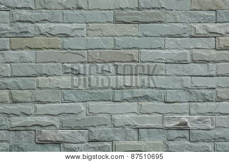 Part of gray square stone wall for background and texture