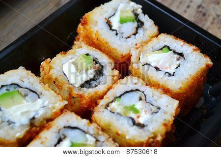 Delicious rolls and sushi with shrimp, cucumber and cream cheese