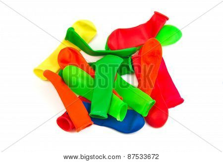 Bunch of not inflated or deflated balloons on a white background
