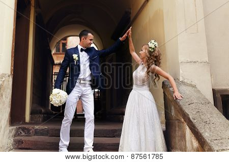 happiness bride and groom giving each other high five poster
