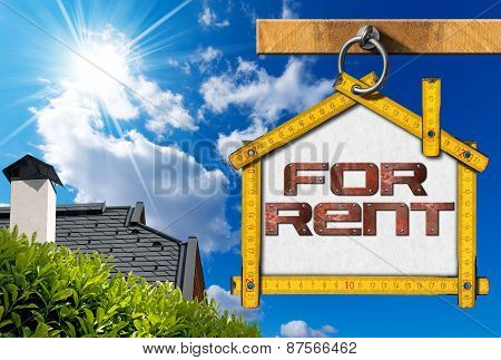 Yellow wooden meter ruler in the shape of house with text for rent. For rent real estate sign on blue sky with roof clouds and sun rays poster
