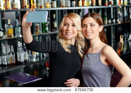 Female friends at the bar