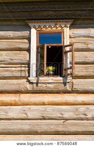 Window In A Wooden Wall.