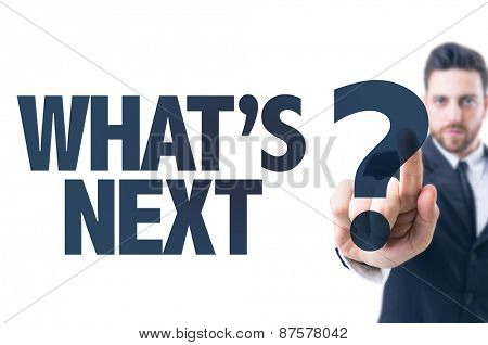 Business man pointing the text: Whats Next?