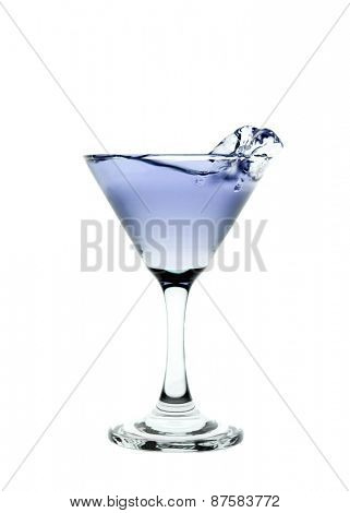 Blue liquid splashing in a martini glass isolated on white background