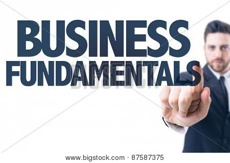 Business man pointing the text: Business Fundamentals
