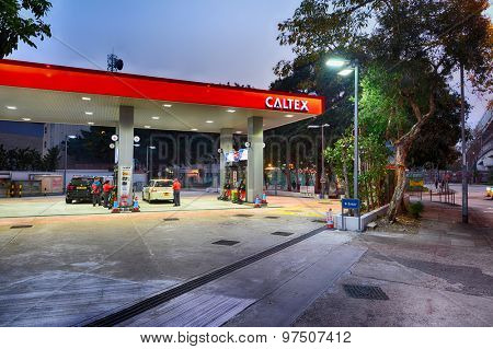HONG KONG - FEBRUARY 04, 2015: Caltex fuel station at evening. Caltex is a petroleum brand name of Chevron Corporation used in more than 60 countries