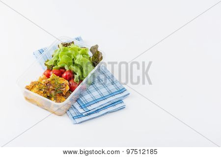 Pangasius fish with mayo mustard sauce cooked by clean food concept and salad in lunch box on white table poster