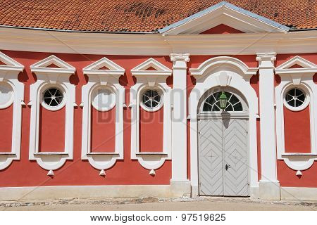 Exterior of the red painted stables building next to Rundale palace in Pilsrundale, Latvia.