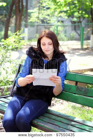 Unhappy Woman Reads The Letter