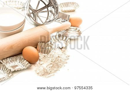 Baking Ingredients And Tolls For Dough Preparation. Flour, Eggs, Rolling Pin