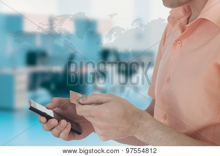 Man Holding Credit Card And Cell Phone Checking Account Balance