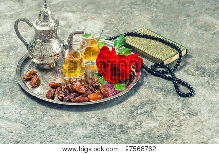 Tea, Red Rose Flower, Dates, Holy Book Quran And Rosary. Islamic Holidays