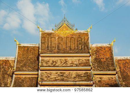 Tiles and roof decoration of Haw Pha Bang in Luang Prabang, Laos poster