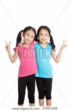 Happy Asian Twins Girls  Smile Show Victory Sign