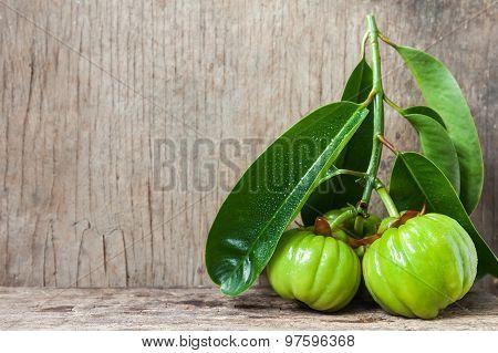 Still Life With Fresh Garcinia Cambogia On Wooden Background (thai Herb)