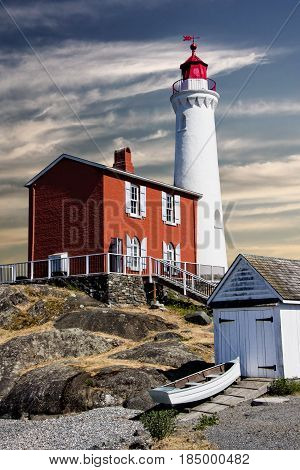 Fisgard Lighthouse, Victoria, Canada: It's night work done, the lighthouse braces itself against a morning sun and a looming change of weather.