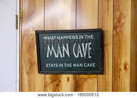 Man Cave sign says that what happens in the mancave stays there.