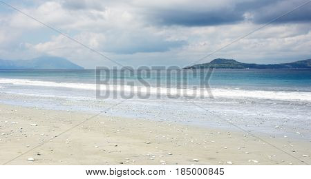 Empty White Sand Beach And Clear Blue Ocean Waves At Bajawa Ruting Flores In The Morning.