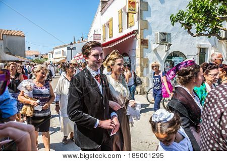 Saintes-Maries-de-la-Mer, Provence, France - May 25, 2015. The concept of ethnographic tourism. Participants in a procession in ancient dresses. Religious feast in honor of the Holy Maries in Provence