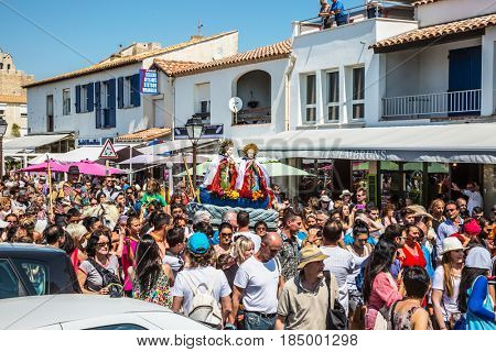 Saintes-Maries-de-la-Mer, France - May 25, 2015. Religious feast in honor of the Holy Maries in Provence. The concept of ethnographic tourism. The crowd is accompanied by two statues Holy Maries