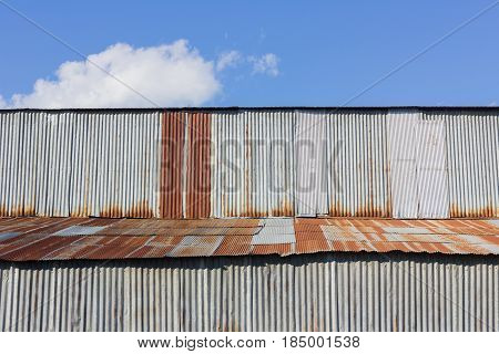 old building made of rusty galvanized iron