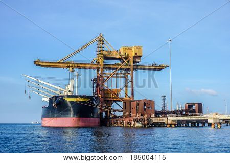 Labuan,Malaysia-May 1,2017:A large bulk carrier supplying iron ore in Antara Steel Mill Plant port at Labuan,Malaysia.The company produces billets and bars including angle bars and U-channels.