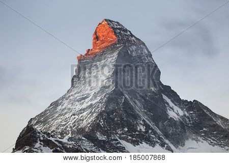 Sun on Matterhorn. A glimpse of the rising sun on the Matterhorn.