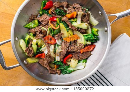 Beef Stir Fry from above. Healthy vegetable & beef stir-fry. Made with flank steak peppers onions and bok choy stir fried in an asian wok.