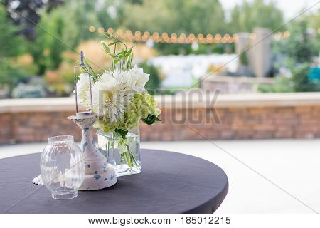 Centerpiece of white and green flowers at a golf course wedding reception in Oregon.
