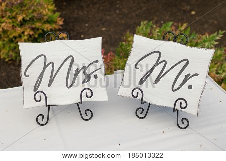 Mr and Mrs signs used for decor at a golf course wedding reception in Oregon.