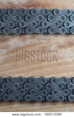 Dirty And Oily Chain From A Mountain Bike Lying On A Wooden Table In A Bicycle Shop