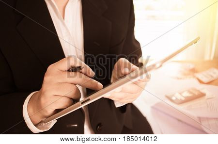 View of hands of successful businessmen use tablet and sitting at meeting room for discussion vintage style