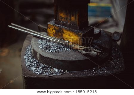 blacksmith's tools lie on the surface in the forge