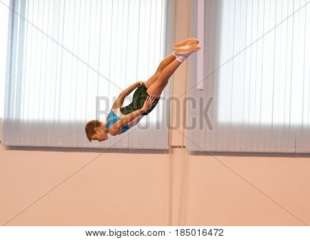 Orenburg, Russia - January 28, 2017: The Boys Compete In Jumping On The Trampoline