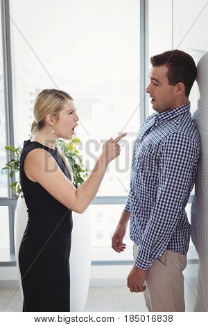 Manager scolding employee in office