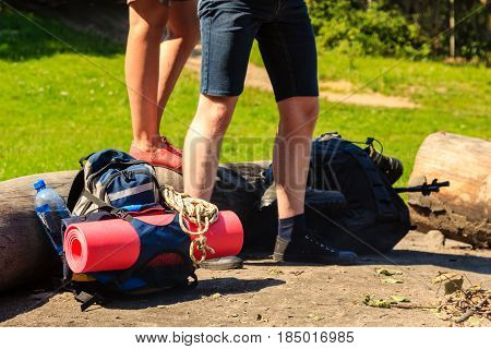 Survival leisure relax holidays nature concept. Couple packed for trip. Young girl and boy taking baggage for outdoor hiking.