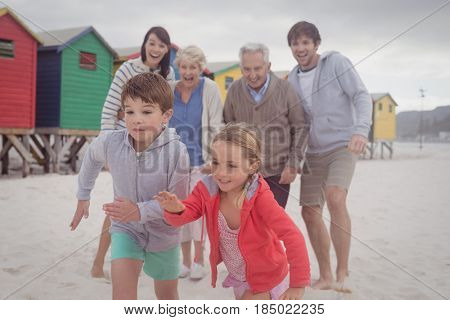 Happy multi-generation family playing at beach