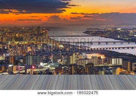 Opening wooden floor Umeda sky view over Osaka central business area with sunset sky background Japan