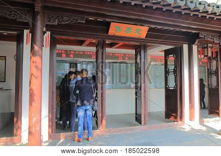 SUZHOU CHINA - NOVEMBER 3, 2016: Unidentified people buy admission for Lion Forest Garden. Lion Forest Garden is recognized with other classical gardens in Suzhou as a UNESCO World Heritage Site.