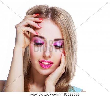 pretty woman with bright pink makeup isolated against white studio background