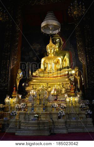 The old Sculpture of a seated Buddha on the altar vihan Buddhist temple of Wat Bovornniwet Wihan. Bangkok, Thailand