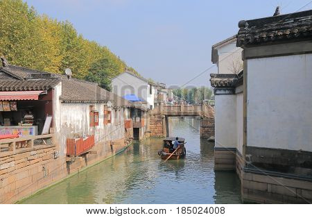 SUZHOU CHINA - NOVEMBER 3, 2016: Unidentified people take a cruise boat in historical district of Suzhou.