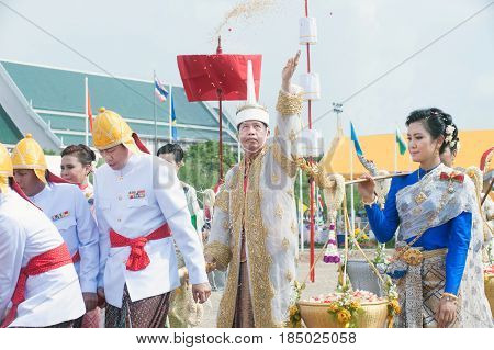BANGKOK, THAILAND - MAY 13,2015 : Unidentified Government officials sowing the grain attend the ceremony -Perform for an auspicious beginning for planting season on the Royal Plowing Ceremony in Bangkok city,Middle of Thailand.