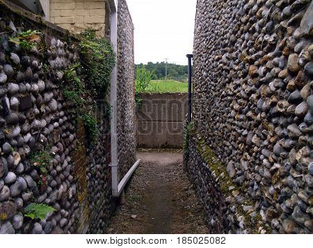 Back Lane in Cley-next-the-Sea Norfolk Showing Norfolk Style Masonry