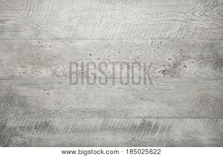 Grey wood texture background viewed from above. The wooden planks are stacked horizontally and have a worn look. This surface would be great as design element for a wall floor table etc...